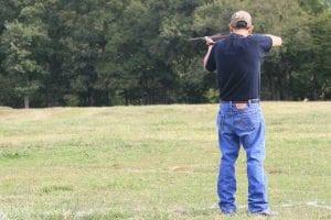 a hunter taking aim at a varmint